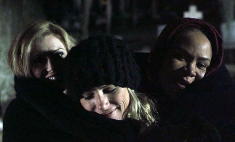 Johanna, Ashley and Joy keep warm