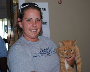 Mason the cat with Kelly the trainer